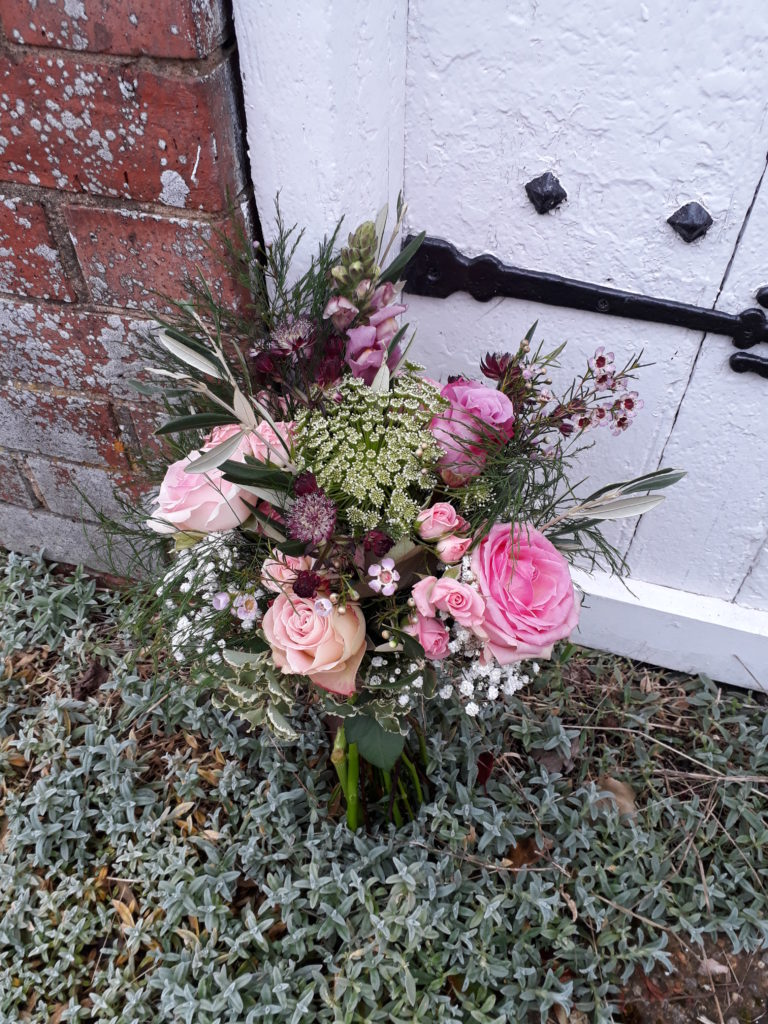 A med/small bouquet with whites, pinks and lilacs