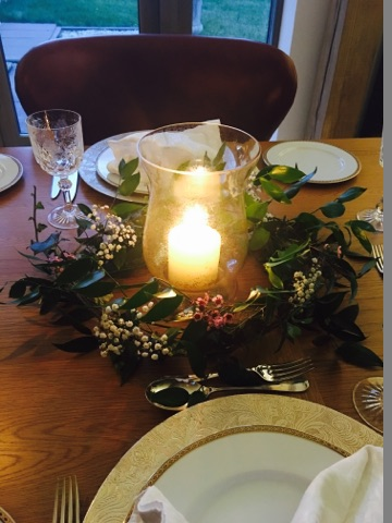 Hurricane lamp with a simple wreath