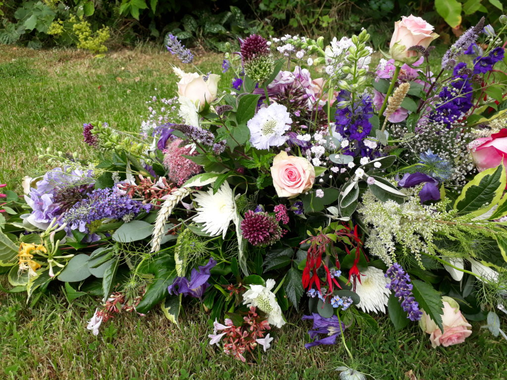 Lots of favourite flowers from Mum's garden were added into the tributes - all her favourite colours