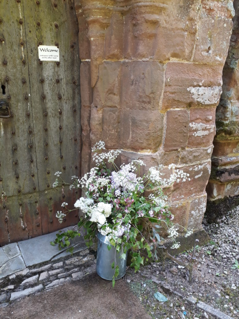 Mini decorative churn by the other church door and later back to Park Farm