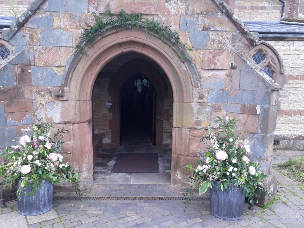 'Dolly tubs' decorating a pretty doorway