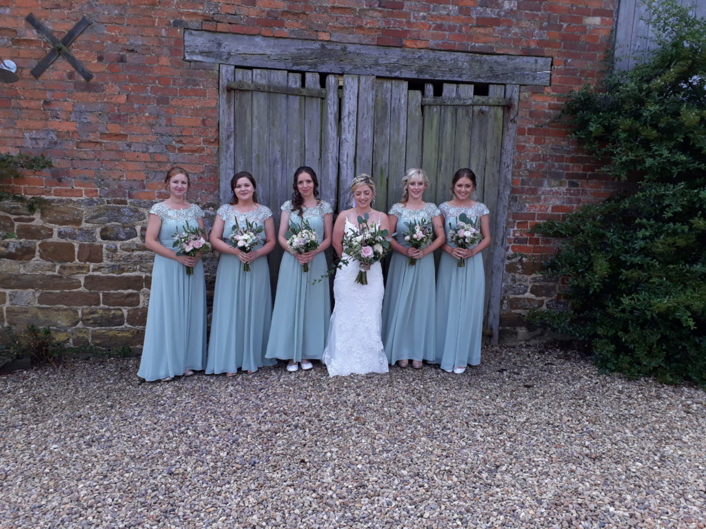 Delicate shades of pastel pinks and whites with foliage chosed to complement the pretty shade of Bridesmaid dresses