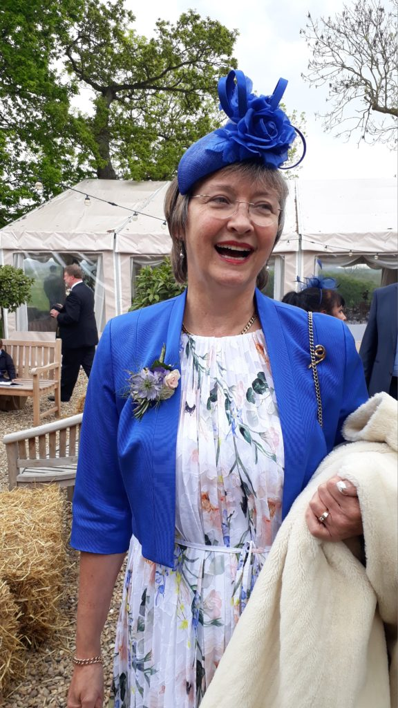 Mother''s corsage complementing pretty Summer flowers outfit