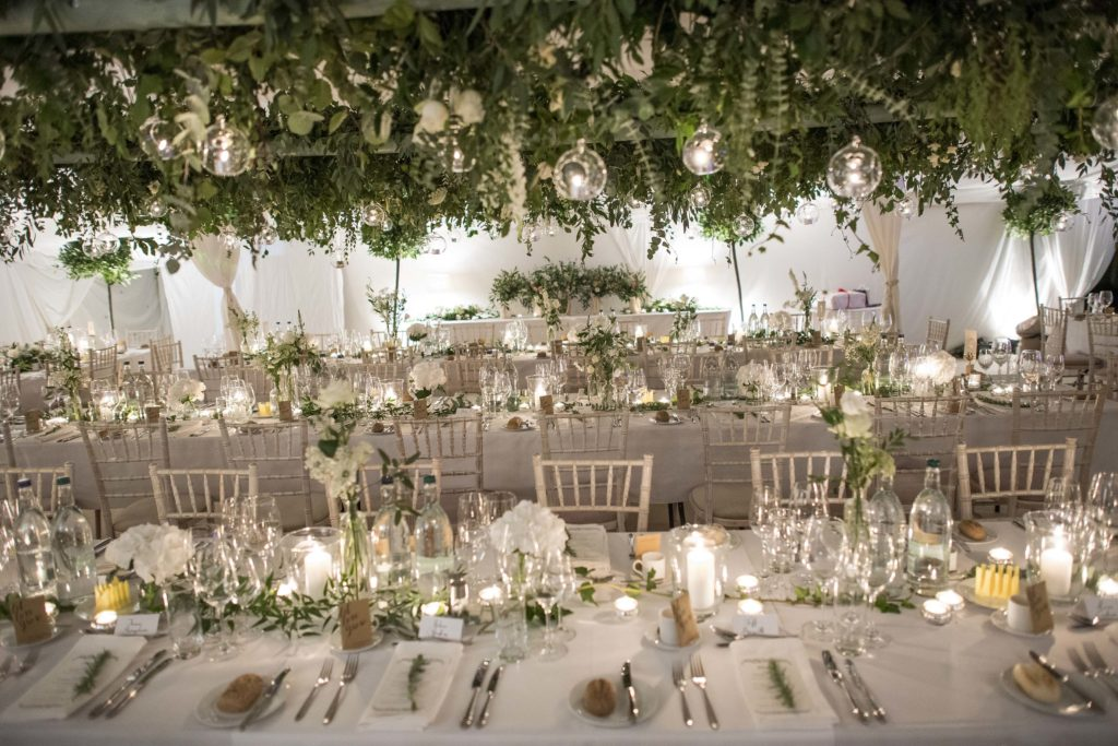 Abundant overhead hanging foliage and flowers with tea light globes.  Photo: Ian Johnson