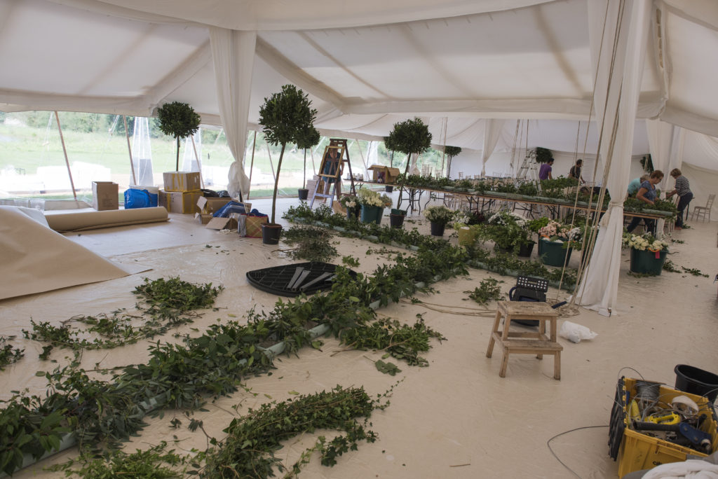 Arranging in full swing for 48 m worth of overhead ladders of hanging flowers.  Photo: Ian Johnson