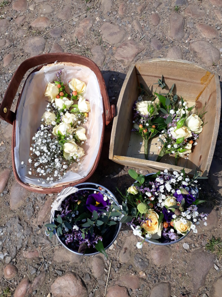 Buttonholes, corsages and hair flowers ready to go.