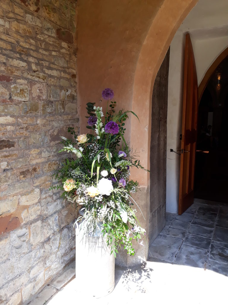 Milk churn at Leamington Hastings church taken back to reception.  Fab Alliums grown by Bride's mum.
