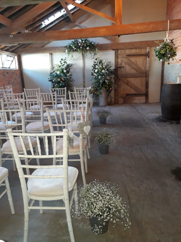 Park Farm looking gorgeous for the ceremony with a fragrant foliage and flower ball hanging from the beam - sweet peas,  honeysuckle, lavender and herbs June 18