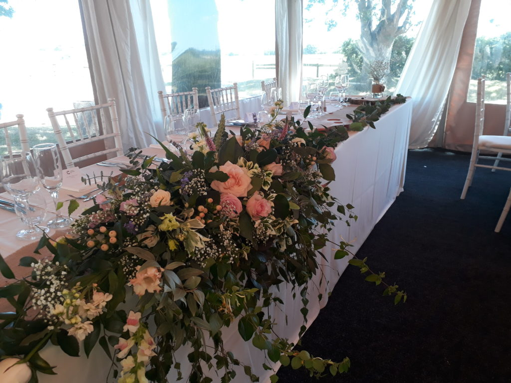 Long and low top table with foliage extending the ful length