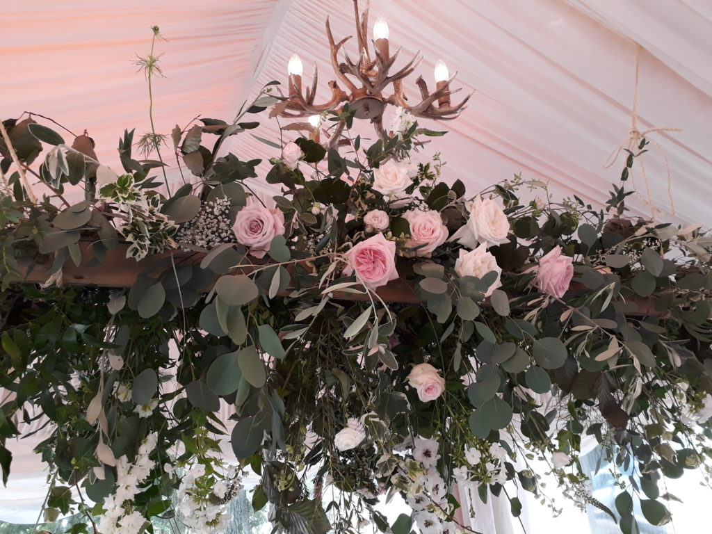 Hanging vintage ladder with Eucalyptus, greenery, larkspur and scented garden roses