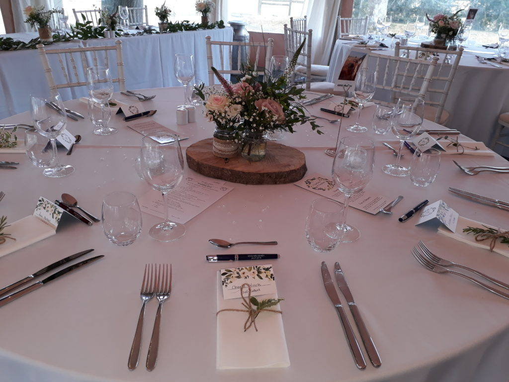 Grouping of jam jars and sprigs of greenery for the tables. July 18