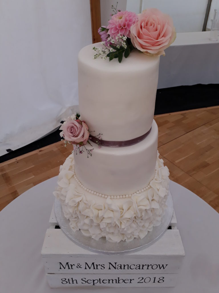 Splendid cake made by the bride's sister and complemented by flowers including garden grown seasonal ones.  Sept 18