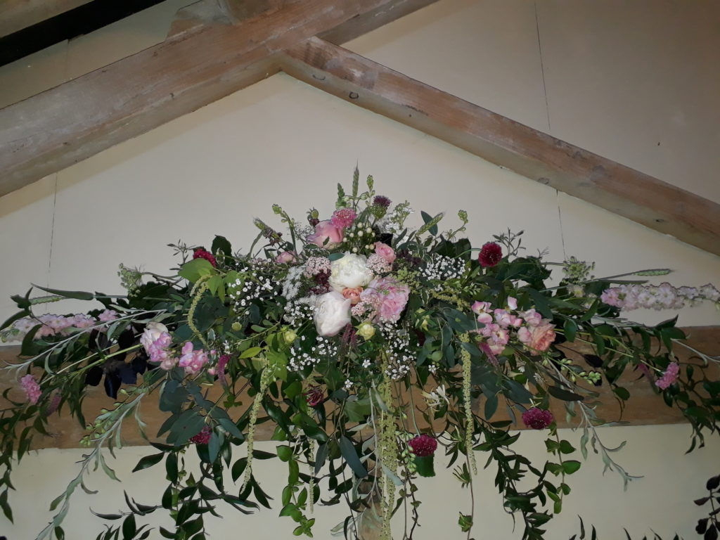 Beam ceremony flowers later moved to Top table centre