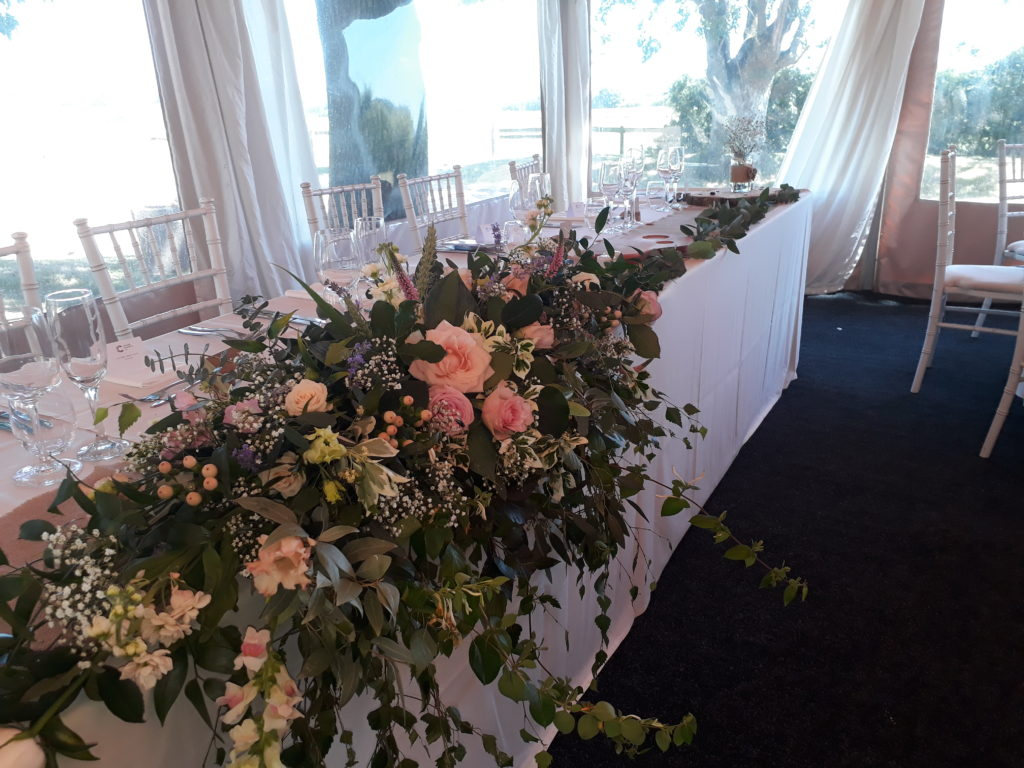Greenery extending down the whole top table