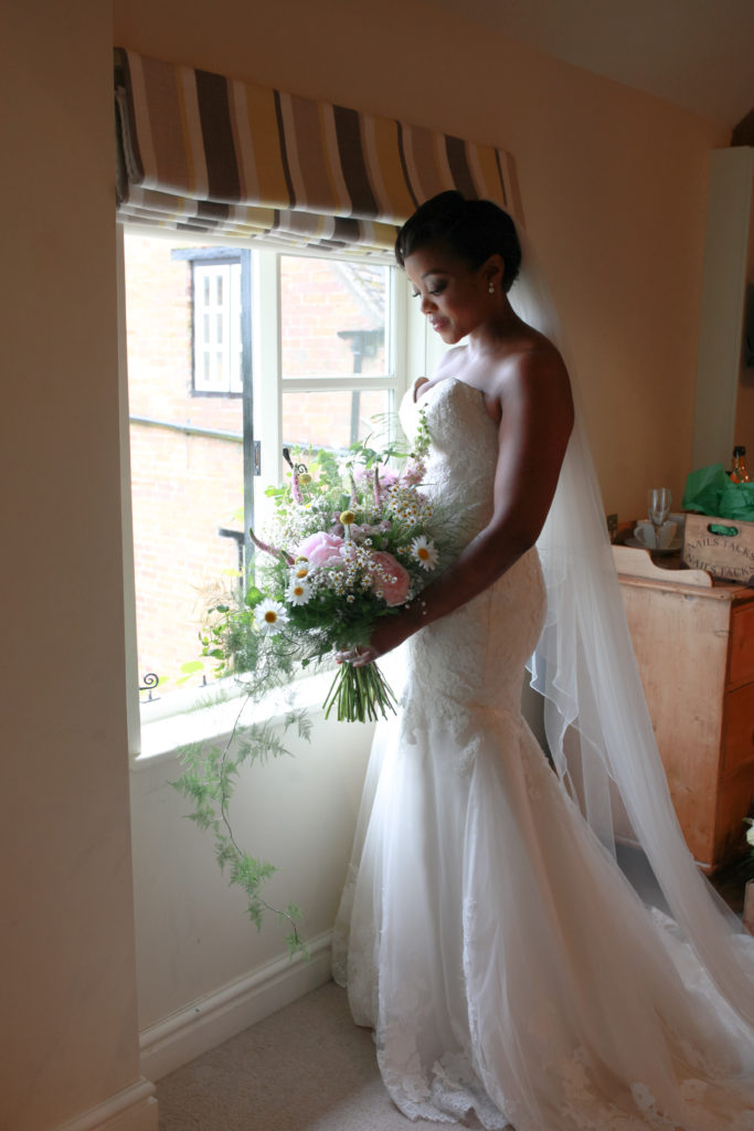 'First look' at lovely full cascading bouquet.  Photo: Andy Bennett