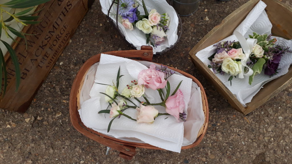 Flowers prepared for Bride's hair and various corsages
