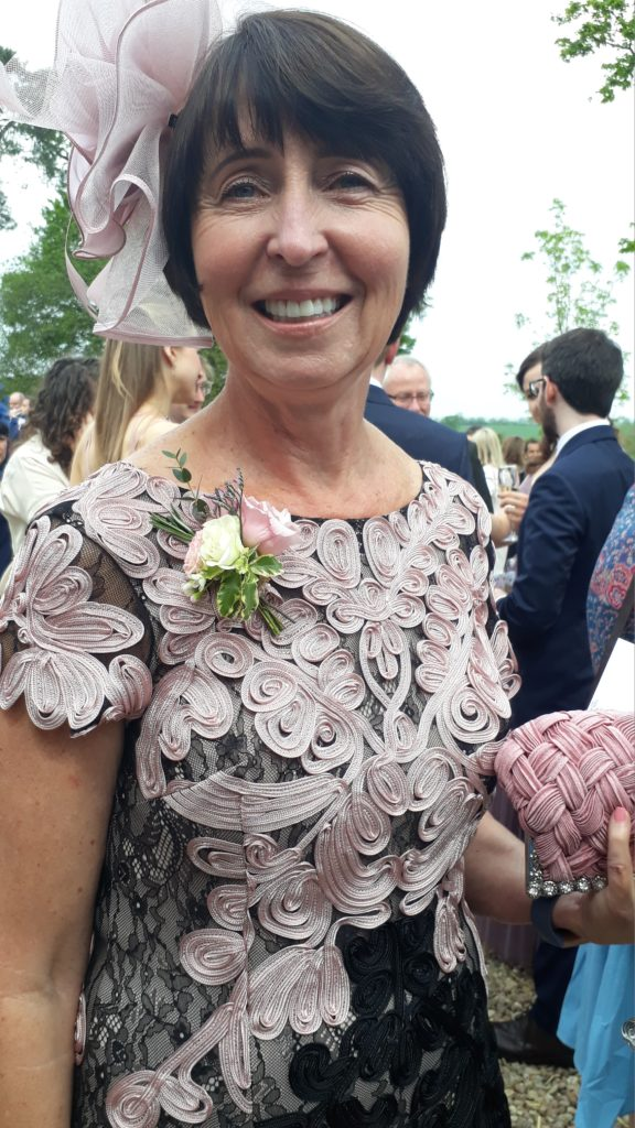 Lightweight Mother's boutonniere complementing the beautiful fabric