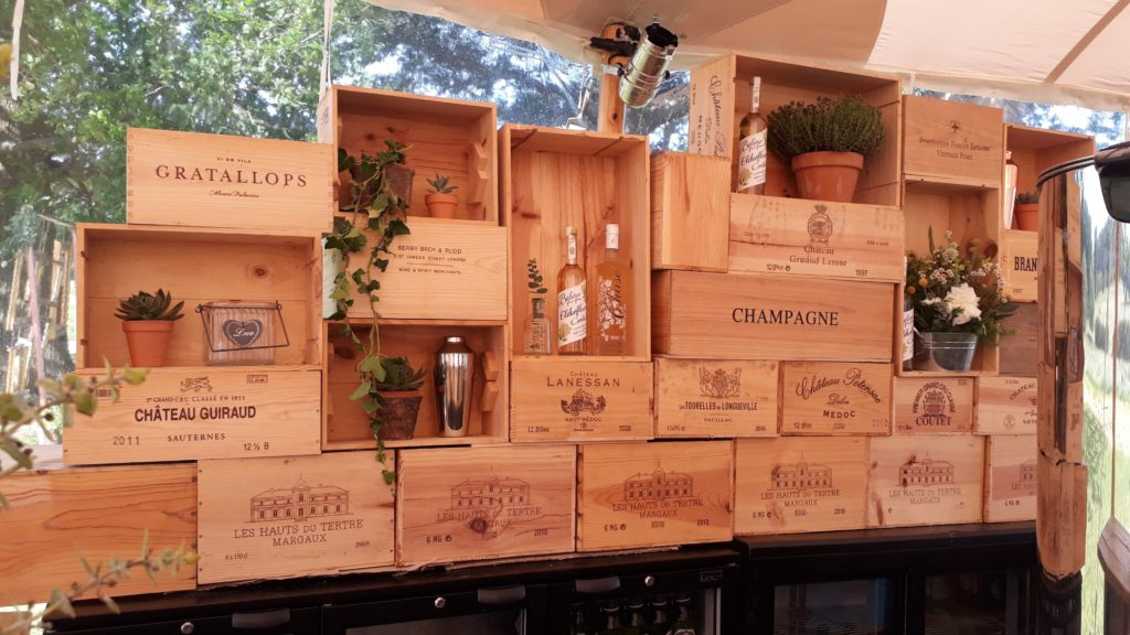 Bar backdrop of champagne boxes