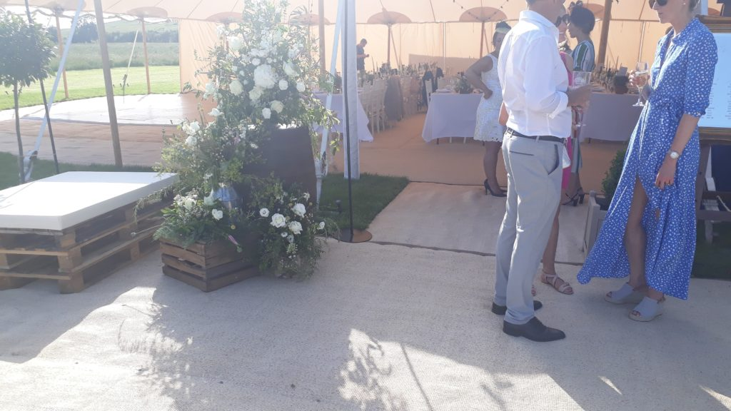 Completed entrance arrangement next to pallet seating