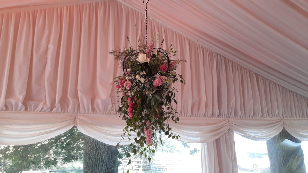 Hanging metal heart above the top table