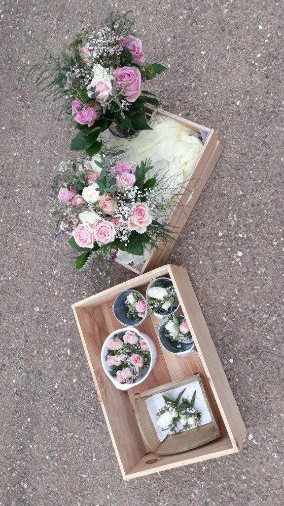 Ready for delivery.  Bride's bouquet planned and made to match  up with silk flower Bridesmaids' ones plus a grave bouquet for a lost loved one.