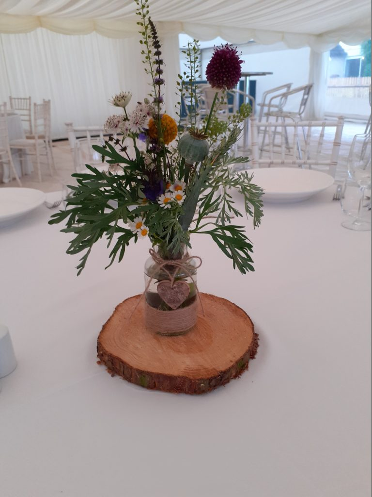 Pretty bottle pew ends then became table centres