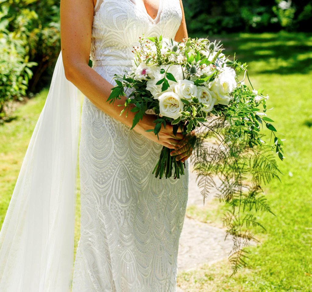 Cropped in to show bouquet with peonies, garden roses and jasmine and other lovely flowers  -Photo: Everybody Smile