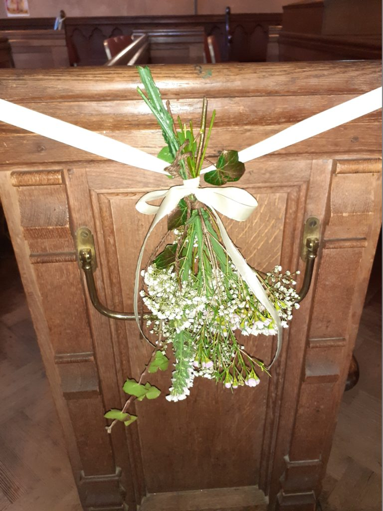 Most church flowers relocated afterwards to reception