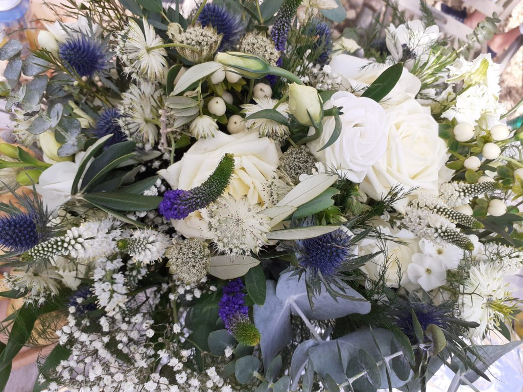 Lovely mix of textures and shades in this bridesmaid's bouquet (complementing navy dress) still looking good the next day at lunchtime get together