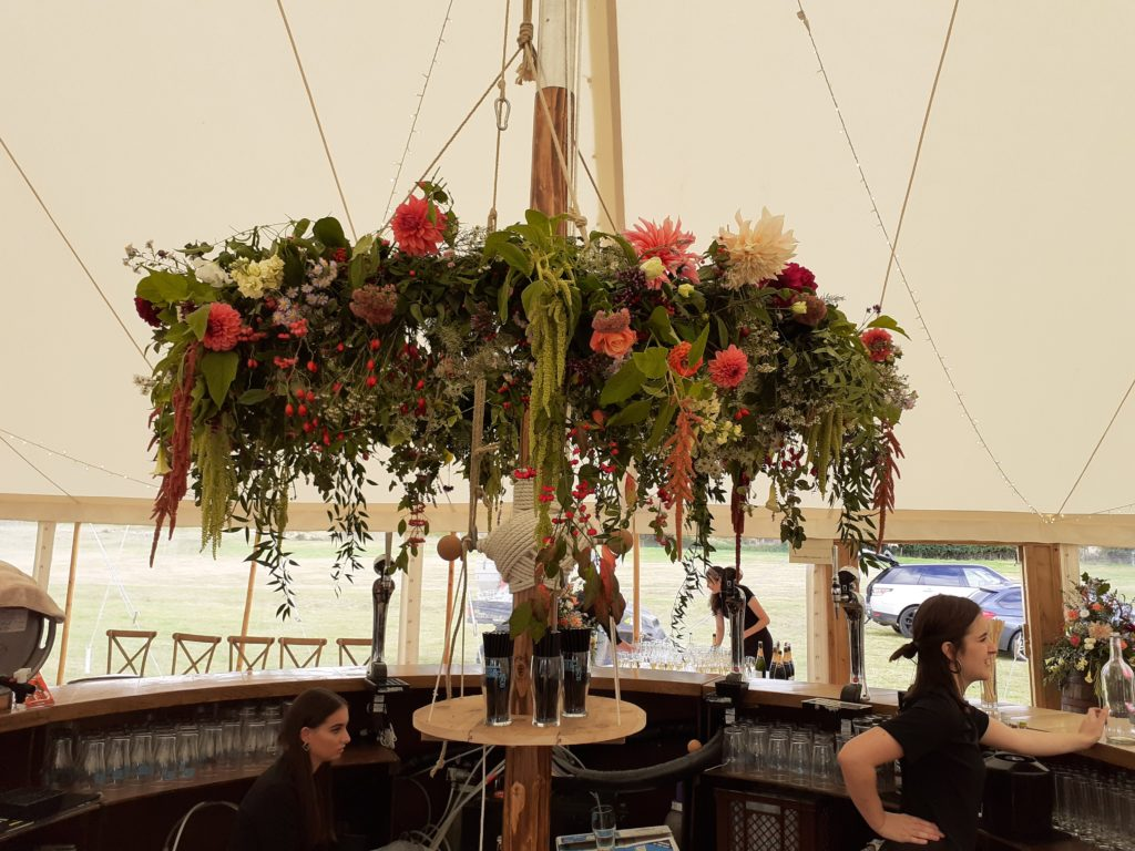 Colourful flower ring above the bar