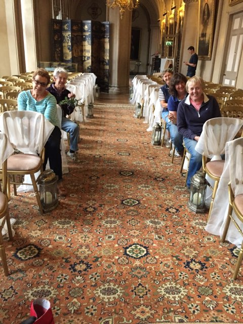Team in action! Decorating the aisle chair backs in Belvoir Castle Ballroom