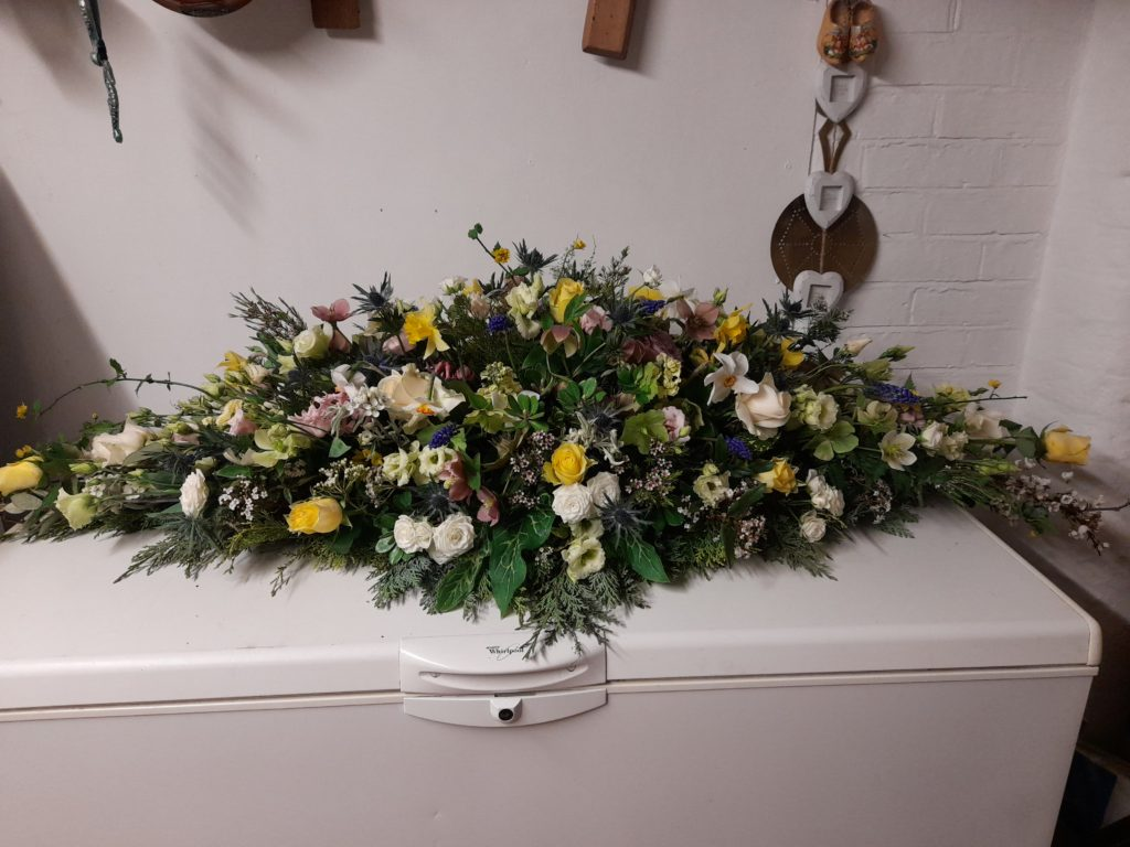 Tribute to a dear friend including flowers from her garden and orchard